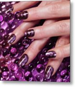 Closeup Of Woman Hands With Purple Nail Polish Metal Print