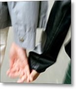 Couple Holding Hands While Strolling Down The Street Metal Print