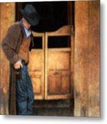 Cowboy By Saloon Doors Metal Print