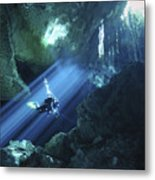Diver Silhouetted In Sunrays Of Cenote Metal Print