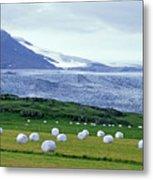 Meadow With Hay Bales And Glaciers Near Jokulsarlon Lagoon In Iceland Metal Print