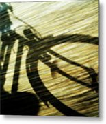 Shadow Of A Person Riding A Bicycle Metal Print