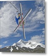 Skiing Aerial Maneuvers Off A Jump Metal Print by Gordon Wiltsie