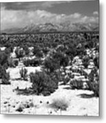 Taos Snowfall Metal Print by Susan Chandler