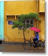 Woman Cycling In Street Metal Print