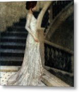 Woman In Lace Gown On Staircase Metal Print