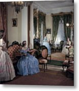 Women In Period Costumes Sit In An Metal Print by Willard Culver