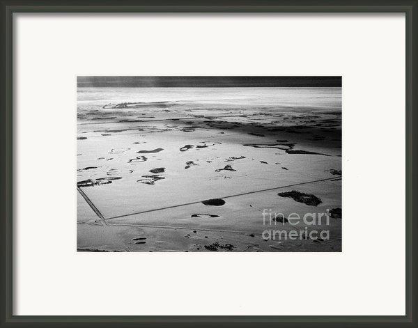 Aerial View Of Snow Covered Prairies And Remote Isolated Farmland In Saskatchewan Canada Framed Print By Joe Fox