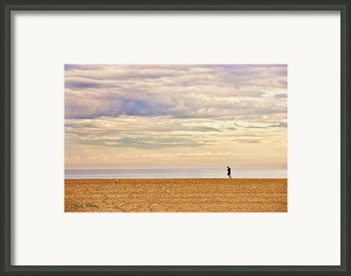 Beach Jogger Framed Print By Chuck Staley