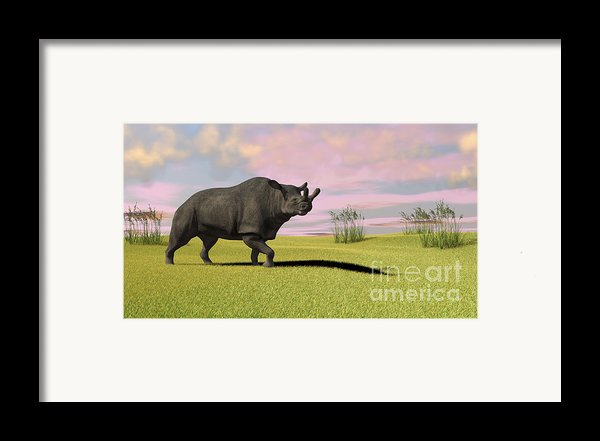Brontotherium Grazing In Prehistoric Framed Print By Kostyantyn Ivanyshen