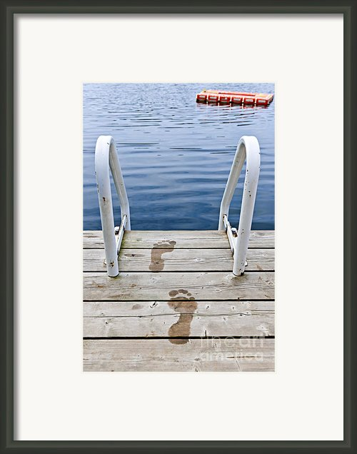 Footprints On Dock At Summer Lake Framed Print By Elena Elisseeva