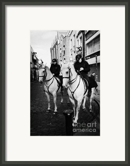 Garda Siochana Mounted Police On Horseback Taking Notes In Temple Bar Dublin Republic Of Ireland Framed Print By Joe Fox