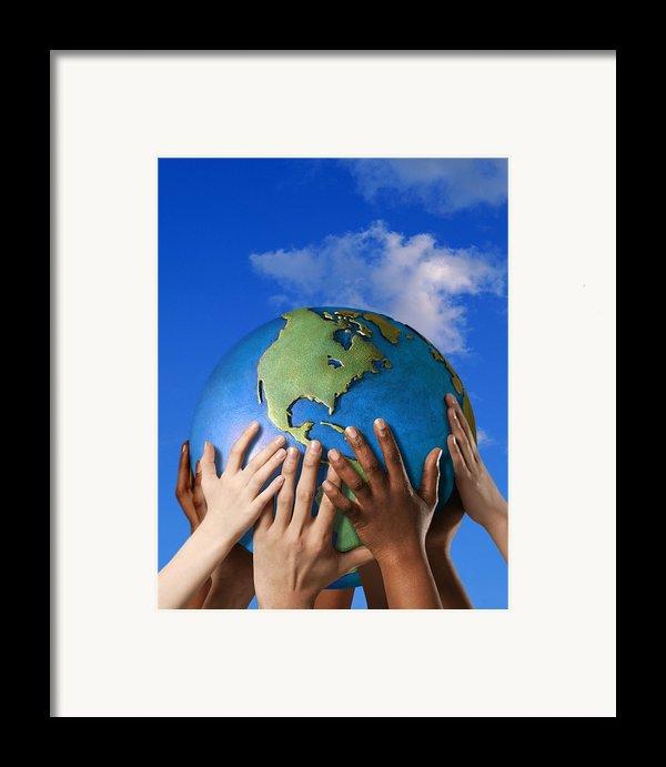 Hands On A Globe Framed Print By Don Hammond