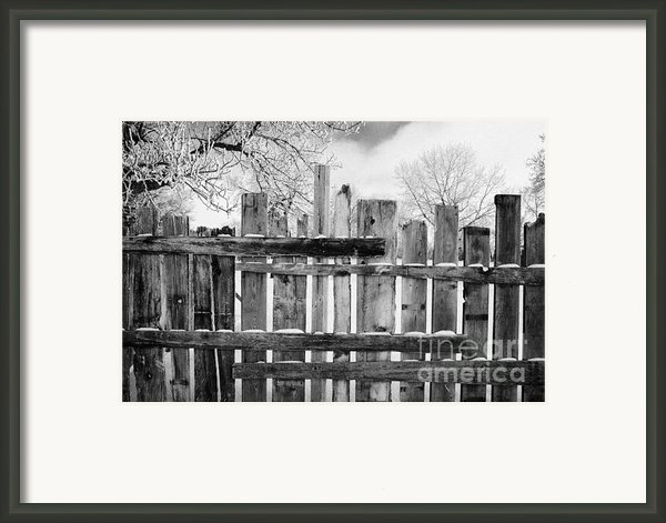 Old Patched Up Wooden Fence Using Old Bits Of Wood In Snow Forget Saskatchewan Canada Framed Print By Joe Fox