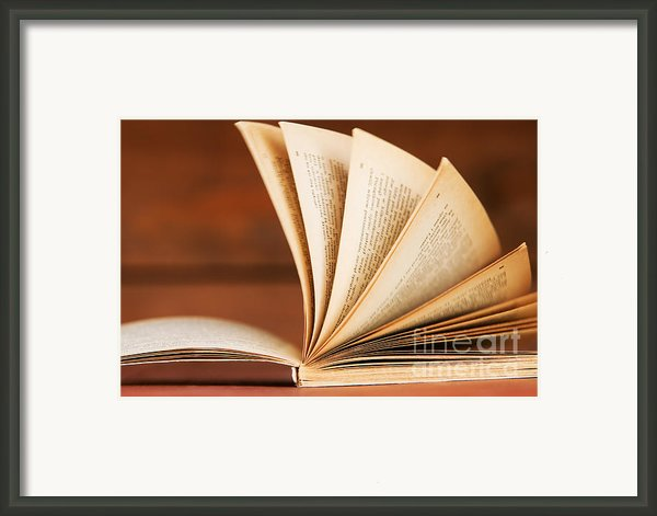 Open Book In Retro Style Framed Print By Michal Bednarek