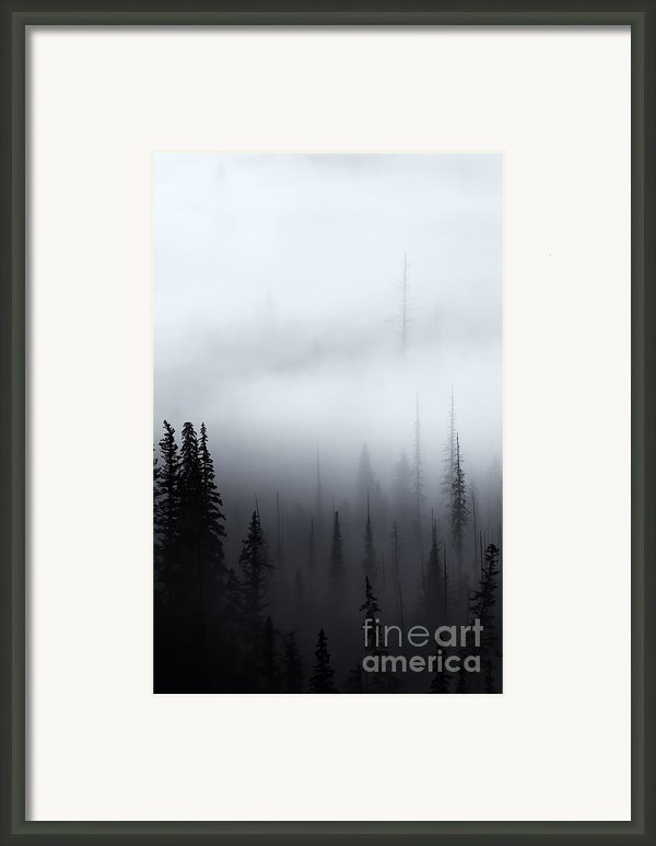 Piercing The Clouds Framed Print By Mike  Dawson