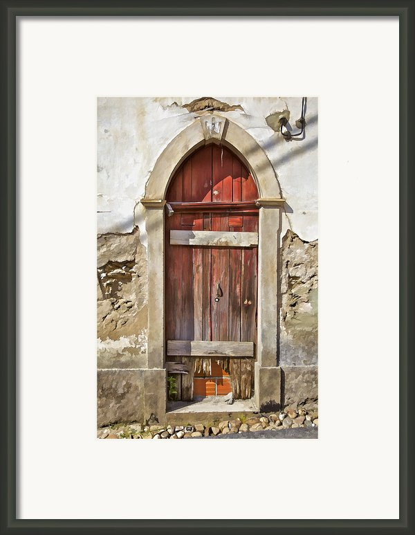 Red Wood Door Of The Medieval Village Of Pombal Framed Print By David Letts