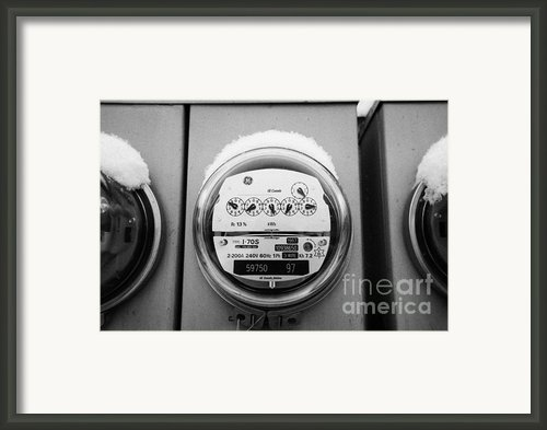 Snow Covered Electricity Meters In Saskatoon Saskatchewan Canada Framed Print By Joe Fox