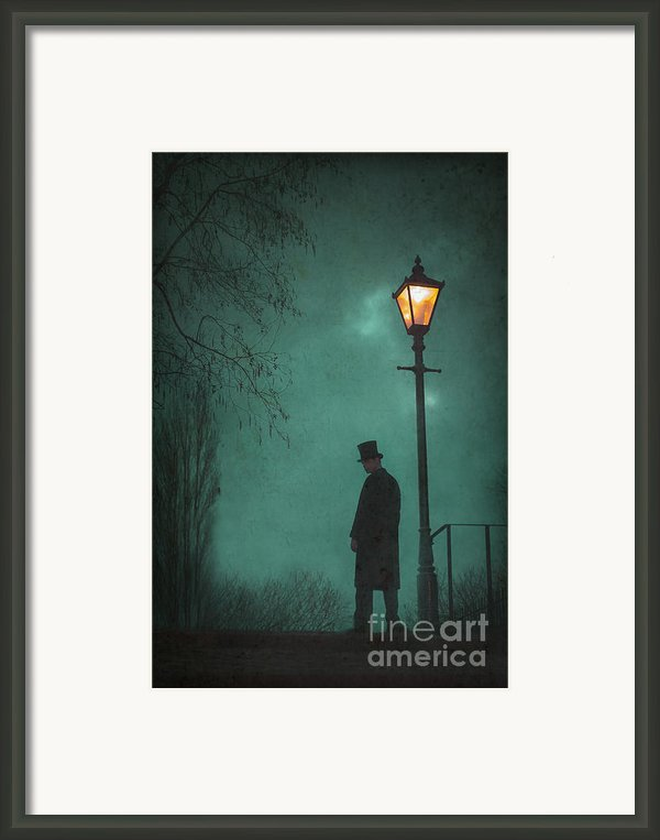 Victorian Man Standing Next To An Illuminated Gas Lamp Framed Print By Lee Avison