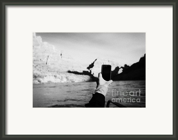 Man Taking Photos With Smartphone During Boat Ride Along The Colorado River In The Grand Canyon Ariz Framed Print By Joe Fox
