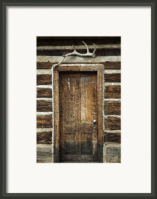 Rustic Cabin Door Framed Print By John Stephens