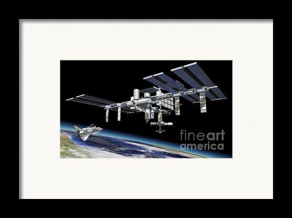 Space Station In Orbit Around Earth Framed Print By Leonello Calvetti