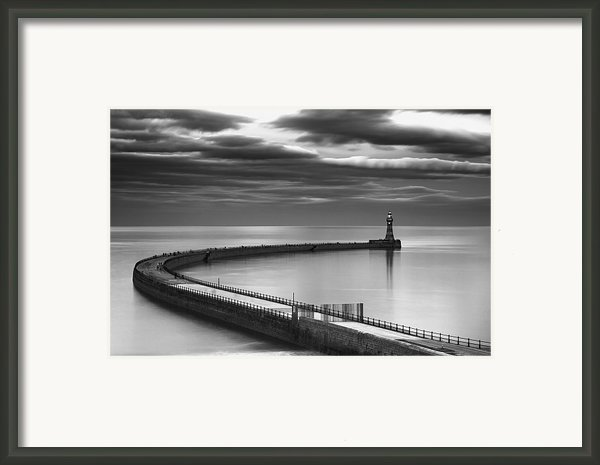 A Curving Pier With A Lighthouse At The Framed Print By John Short