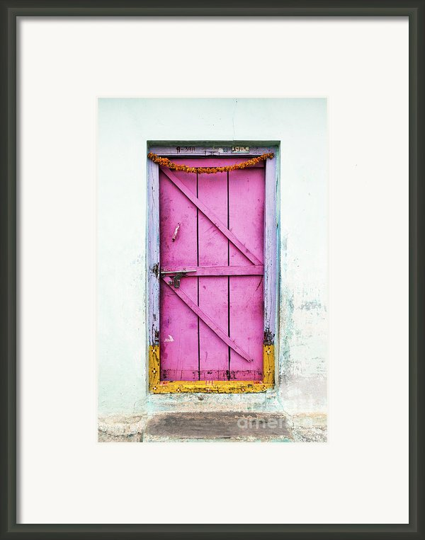 A Pink Door Framed Print By Tim Gainey