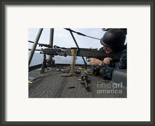A Sailor Fires An M-240b Machine Gun Framed Print By Stocktrek Images