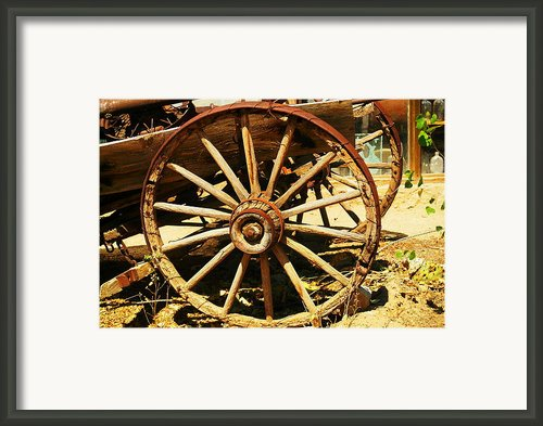 A Wagon Wheel Framed Print By Jeff  Swan