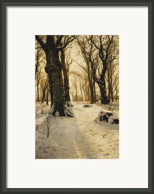 A Wooded Winter Landscape With Deer Framed Print By Peder Monsted
