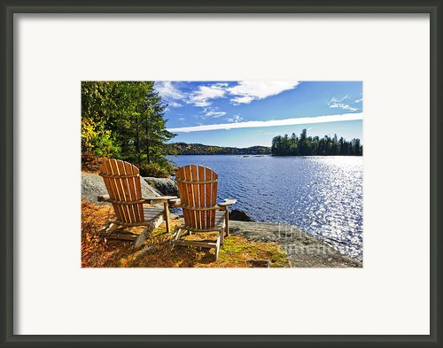 Adirondack Chairs At Lake Shore Framed Print By Elena Elisseeva