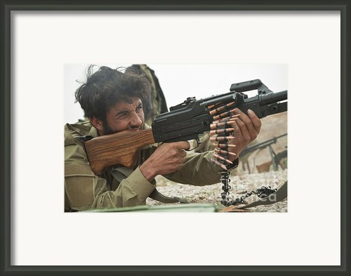 An Afghan Local Police Officer Fires Framed Print By Stocktrek Images