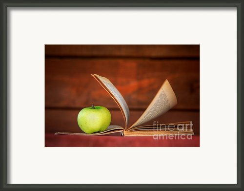 Apple And Book Framed Print By Michal Bednarek