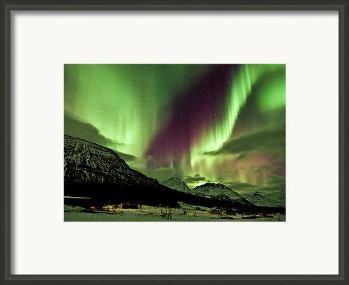Aurora Above The Mountains Framed Print By David Bowman