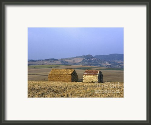 Bales Of Straw Stacked In The Shape Of A House Next To A Little Stone House. Limagne. Auvergne. Fran Framed Print By Bernard Jaubert