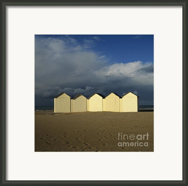 Beach Huts Under A Stormy Sky In Normandy Framed Print By Bernard Jaubert