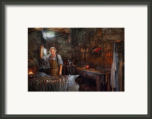 Blacksmith - Working The Forge  Framed Print By Mike Savad