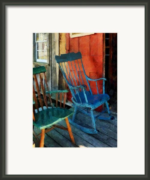 Blue Chair Against Red Door Framed Print By Susan Savad