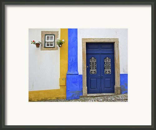 Blue Door Of Medieval Obidos Framed Print By David Letts