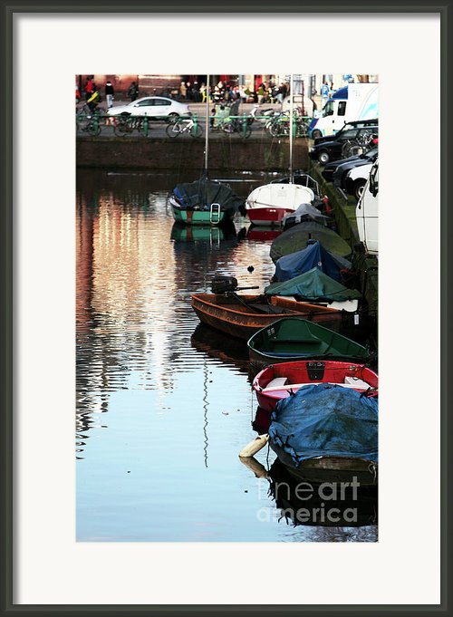 Boats In The Red Light District Framed Print By John Rizzuto