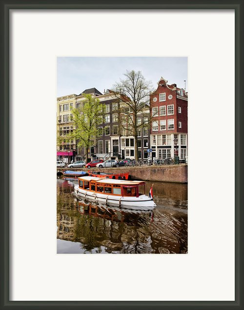Boats On Canal In Amsterdam Framed Print By Artur Bogacki