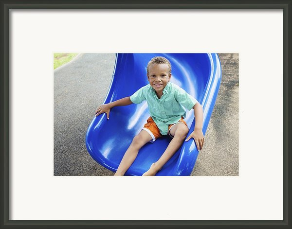 Boy On Slide Framed Print By Kicka Witte