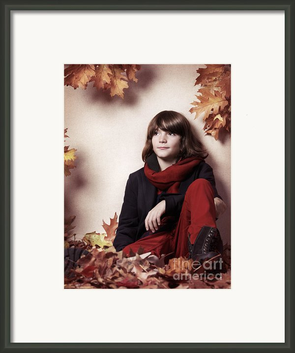 Boy Sitting On Autumn Leaves Artistic Portrait Framed Print By Oleksiy Maksymenko