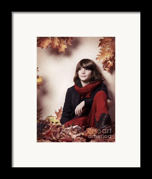 Boy Sitting On Autumn Leaves Artistic Portrait Framed Print By Oleksiy Maksymenko
