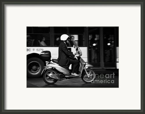 Business Man In Suit And White Helmet On Scooter Commutes Past Bus Full Of Passengers Through Piazza Framed Print By Joe Fox
