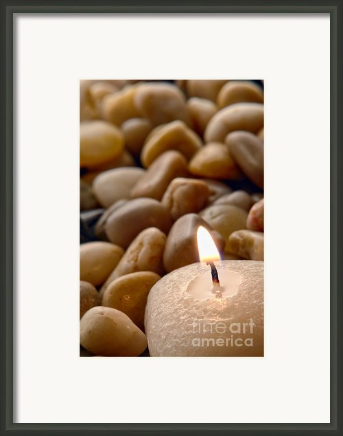 Candle On The Rocks Framed Print By Olivier Le Queinec