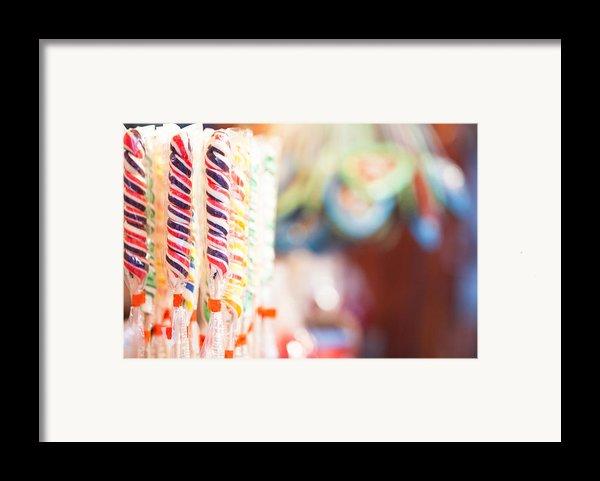 Candy Sticks At German Christmas Market Framed Print By Susan  Schmitz