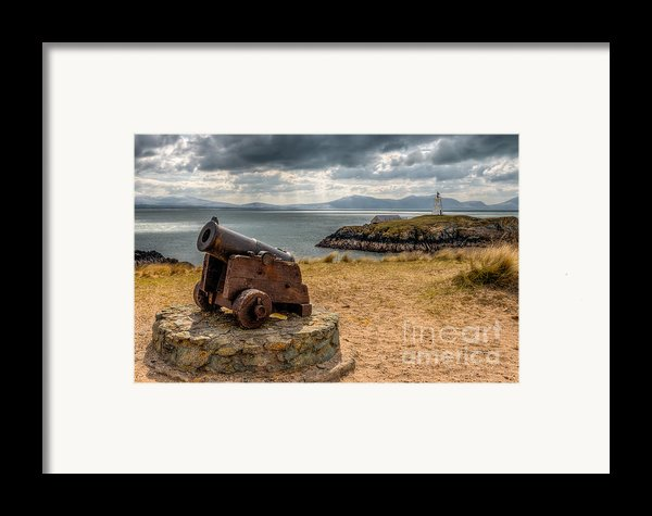 Cannon At Llanddwyn  Framed Print By Adrian Evans
