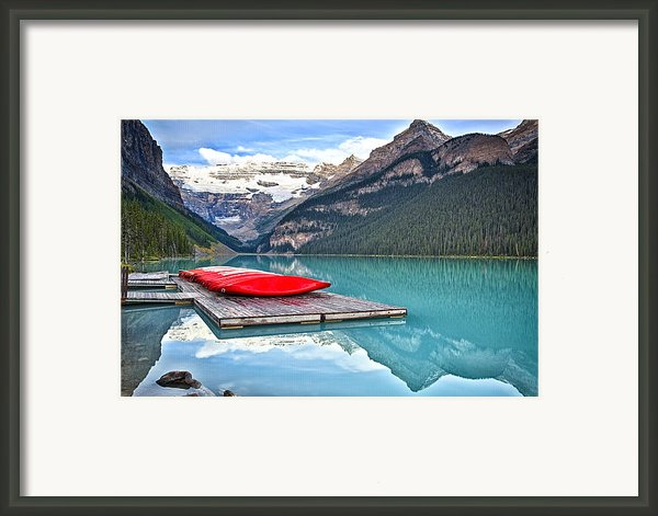 Canoes Of Lake Louise Alberta Canada Framed Print By George Oze
